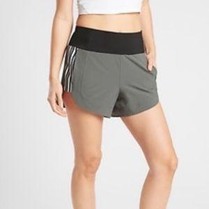 Athleta Ascender Athletic shorts 4 inch zip pocket